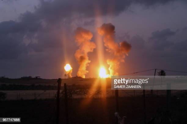 TOPSHOT Smoke and fire rises following an Israeli air strike on Beit Hanun in the northern of Gaza Strip on May 12 2018