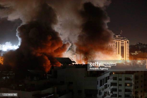 Smoke and flame rise after Israeli army carried out attacks over buildings in Gaza City, Gaza on May 18, 2021.
