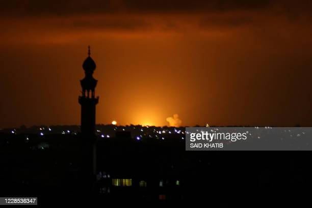 Smoke and flames are seen following an Israeli air strike in the Khan Yunis town of the southern Gaza Strip on September 16, 2020. - Israel bombed...