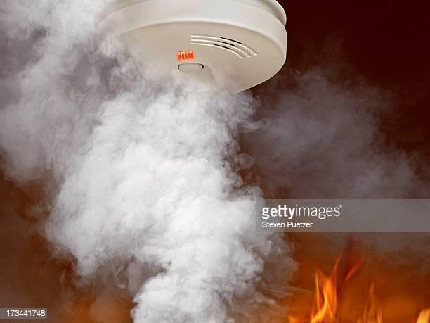 Smoke and flames around smoke detector