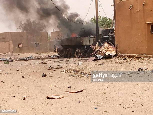 Smoke and flames ascend from an army armoured vehicle in Gao northwestern Mali following an explosion on July 1 2018 French soldiers operating in...