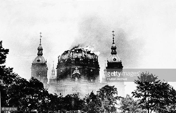 Smoke and flames envelop the central dome of the Berlin Cathedral after an allied bombing raid during World War Two Germany May 24 1944
