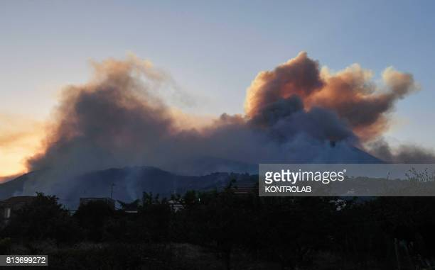 Smoke and flames from the wild fires burning on the vesuvius, Campania Southern Italy.