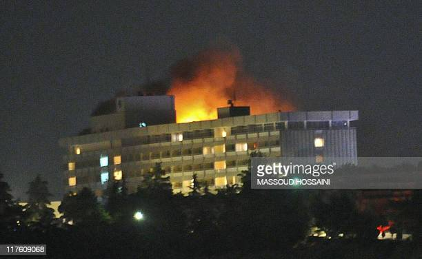 Smoke and flames light up the night from a blaze at the Intercontinental hotel after an attack on the hotel by Taliban fighters and a response by...