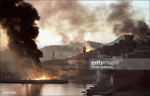 Smoke and flames pour from the harbour and from inside the walled city 12 November 1991 after the Croatian town of Dubrovnik suffered the heaviest...