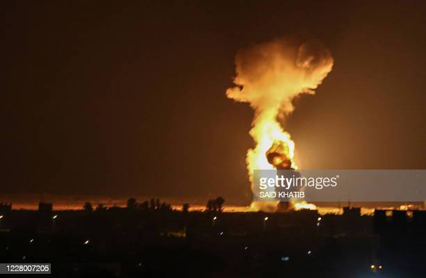 Smoke and flames rise after war planes belonging to the Israeli army carried out airstrikes over the southern Gaza Strip city of Rafah on August 12,...