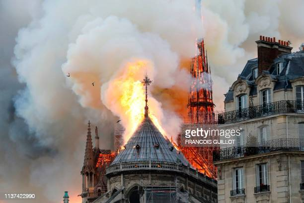 Smoke and flames rise during a fire at the landmark Notre-Dame Cathedral in central Paris on April 15 potentially involving renovation works being...