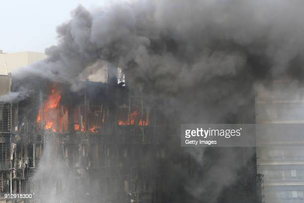 Smoke and flames rise from an apartment building on February 1 2018 in Zhengzhou China The fire broke out at around 140 pm and there are no reports...