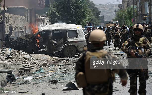 Smoke and flames rise from burning vehicles at the site of a bomb blast that targeted NATO forces in Kabul on July 7 2015 A bomb blast targeted NATO...