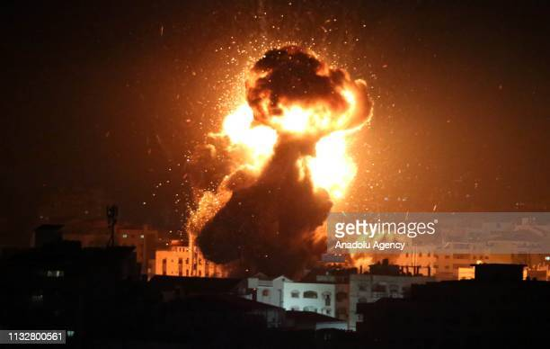 Smoke and flames rise from Head of the Political Bureau of Hamas Ismail Haniyeh's office in western Gaza after Israeli warplanes carry out a fresh...