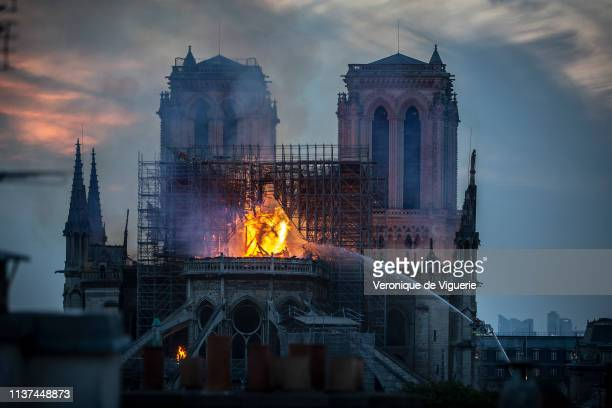 Smoke and flames rise from NotreDame Cathedral on April 15 2019 in Paris France A fire broke out on Monday afternoon and quickly spread across the...