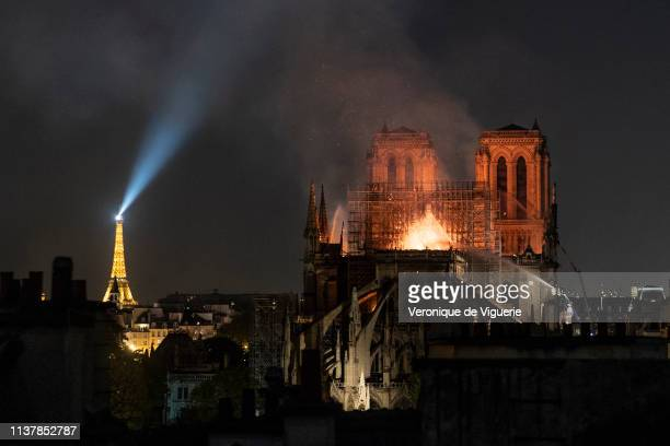 Smoke and flames rise from Notre-Dame Cathedral on April 15, 2019 in Paris, France. A fire broke out on Monday afternoon and quickly spread across...