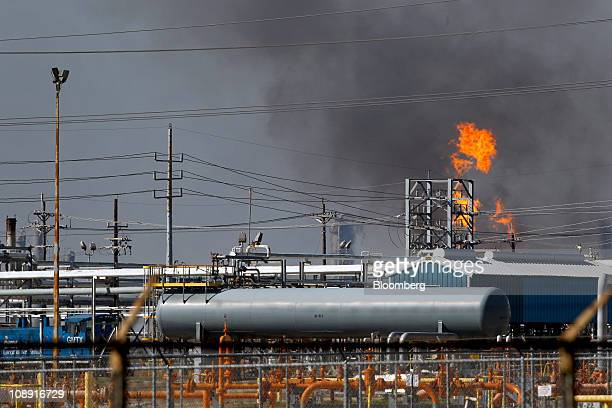 Smoke and flames rise from the Enterprise Products Partners LP Mont Belvieu plant after an explosion in Mont Belvieu Texas US on Tuesday Feb 8 2011...