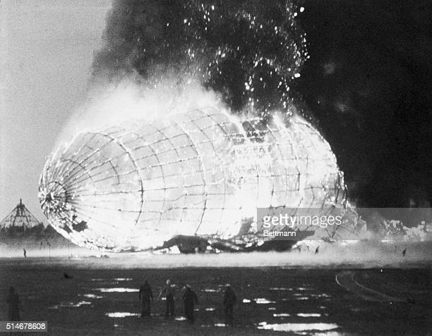 Smoke and flames rise from the Hindenburg a German airship which exploded on mooring at a naval air station on May 6 killing 36 people and ending an...