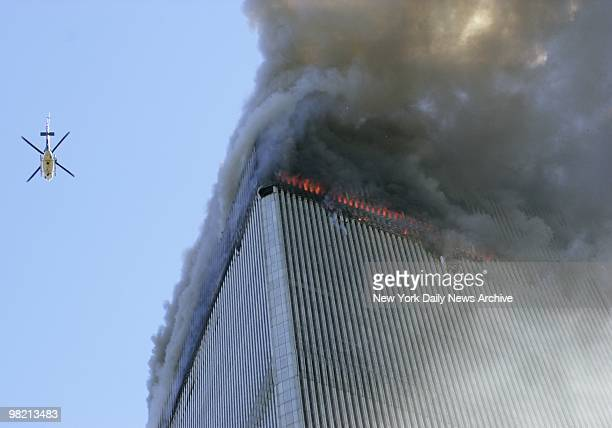 Smoke and flames spew from on of the towers of the World Trade Center the aftermath of a terrorist attack on September 11 2001 in New York City A...