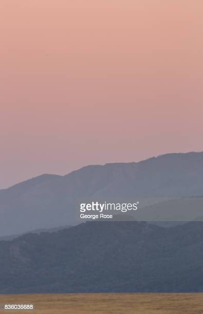 Smoke and haze fill the sky at sunset on August 8 near Santa Ynez California Following a series of winter storms on the Central Coast cutting into...