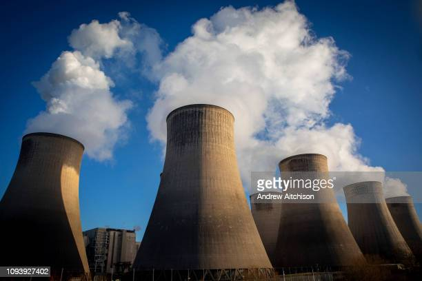 Smoke and steam bellows from the chimneys and cooling towers of RatcliffeonSoar coal fired power station owned and operated by Uniper at...