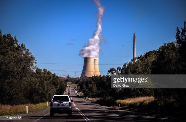 Smoke and steam rises from the Bayswater coalpowered thermal power station located near the central New South Wales town of Muswellbrook New South...
