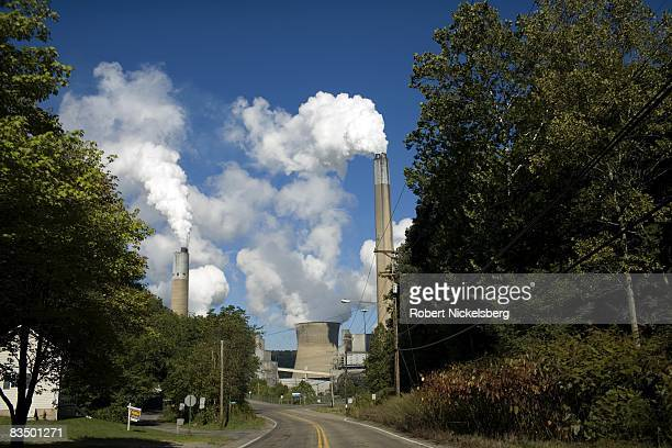 Smoke and steam vapor pour out of the Bruce Mansfield Power Plant overlooking a road leading into Shippingport on September 10 2008 in Shippingport...