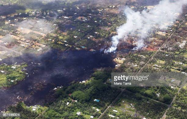 Smoke and volcanic gases rise as lava cools in the Leilani Estates neighborhood in the aftermath of eruptions and lava flows from the Kilauea volcano...