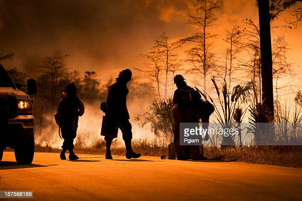 smoke and wilderness emergency - firefighter stock pictures, royalty-free photos & images
