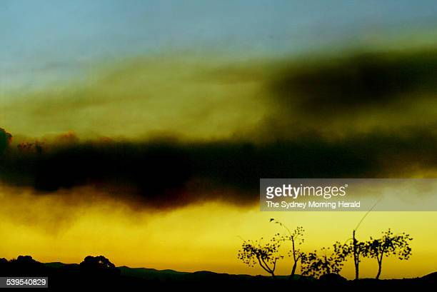 Smoke appears over the hills as the sun sets this afternoon in Canberra on 10 may 2005 The view from Parliament House SMH NEWS Picture by CHRIS LANE