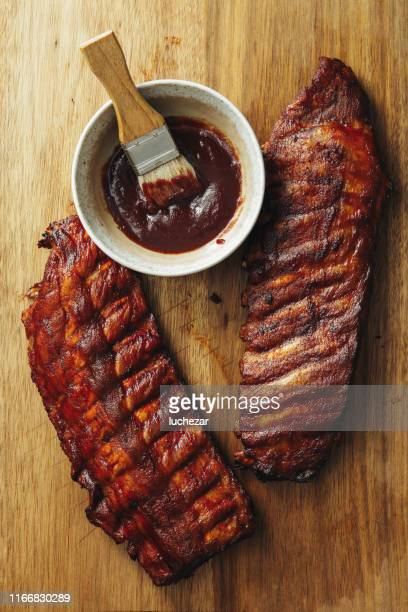 smoke barbecue pork ribs - barbeque sauce stock photos and pictures