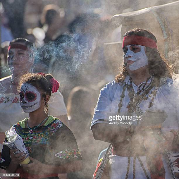 CONTENT] Smoke Bearers dressed in Calavera style bless the beginning of the annual Marigold Parade which takes place in the South Valley of...