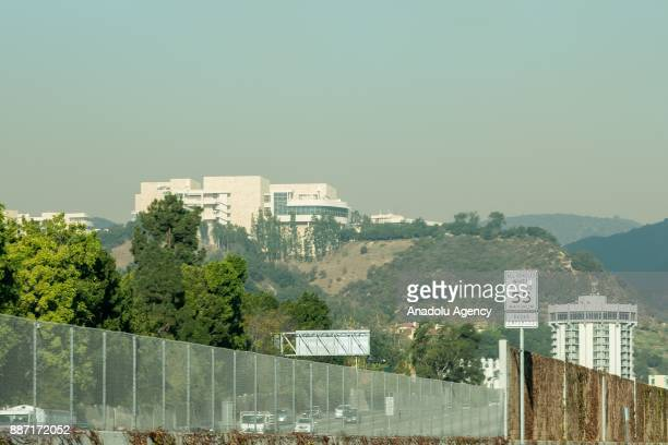 Smoke begins to cloud around the Getty Center as the Skirball Fire burns Wednesday December 6 2017 in Bel Air California United States Interstate 405...