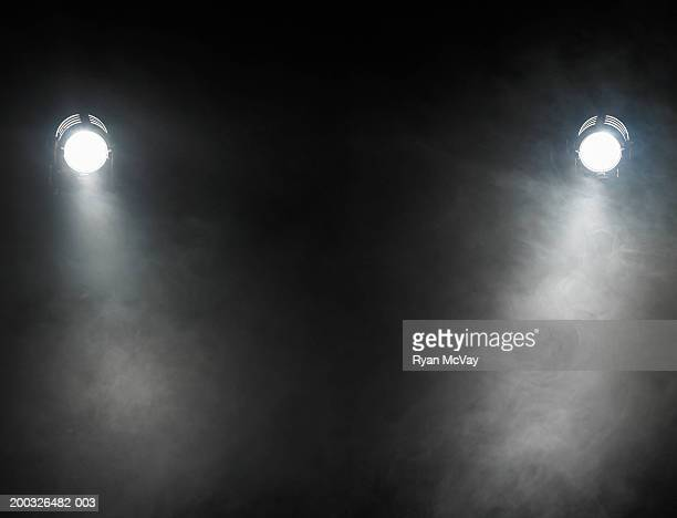 smoke beneath spotlights - spotlight stock photos and pictures