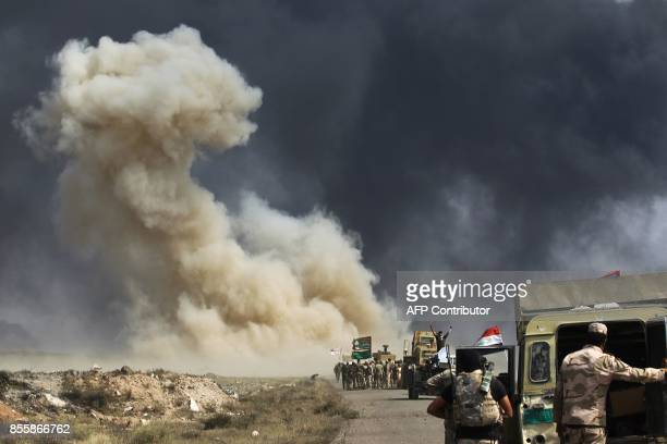 TOPSHOT Smoke billow as Iraqi forces advance towards the Islamic State group's stronghold of Hawija on September 30 2017 to recapture the town from...