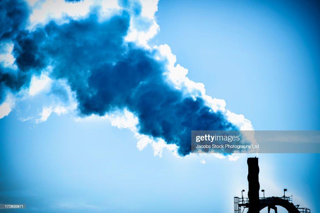 Smoke billowing from factory smoke stack : Stock Photo