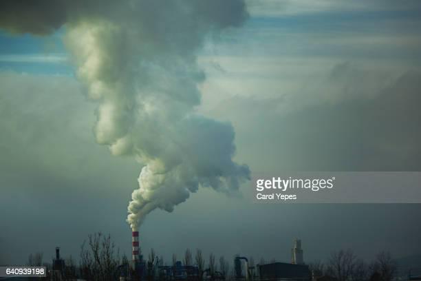 smoke billowing from industrial plan