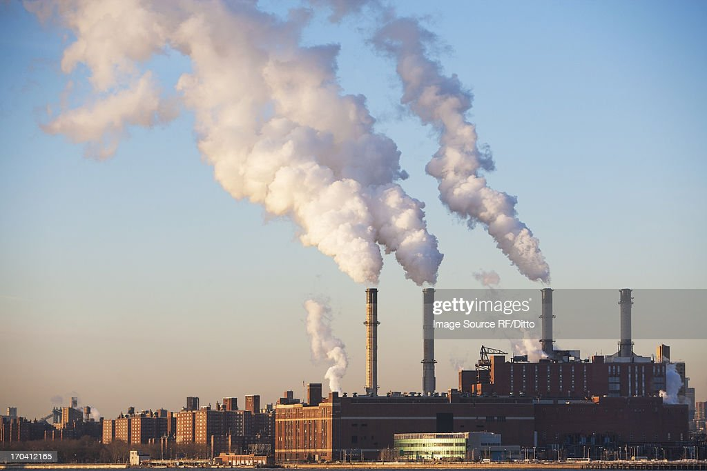 Smoke billowing from industrial plant : Stock Photo