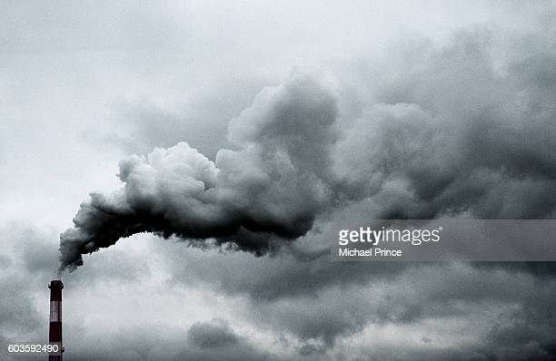 smoke billowing from smokestack - chimney stock pictures, royalty-free photos & images