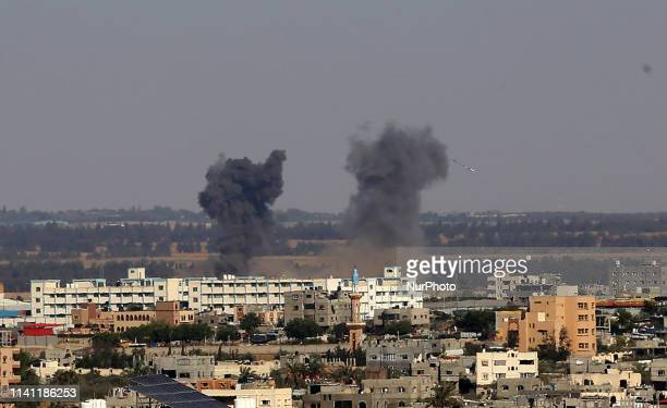 Smoke billows above buildings in Rafah in the southern Gaza Strip during an Israeli airstrike on the Palestinian coastal enclave on May 4 2019 Gaza...