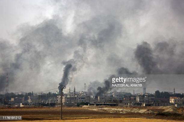 Smoke billows above the key Syrian border town of Ras alAin on October 16 2019 during the ongoing assault by Turkey and its allies on Kurdishheld...