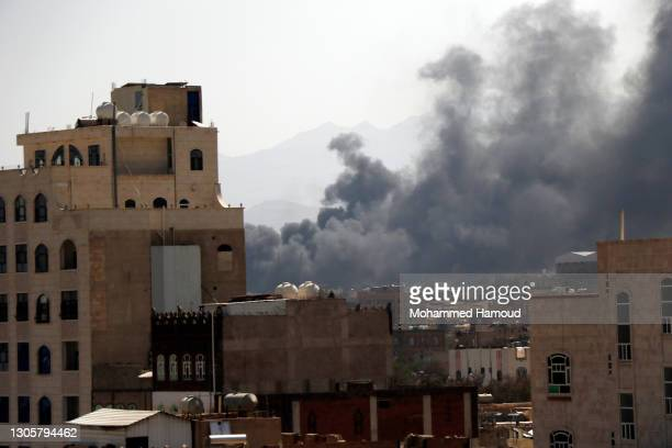 Smoke billows above the residential area following airstrikes of the Saudi-led coalition targeting Houthi-held military positions on March 07, 2021...