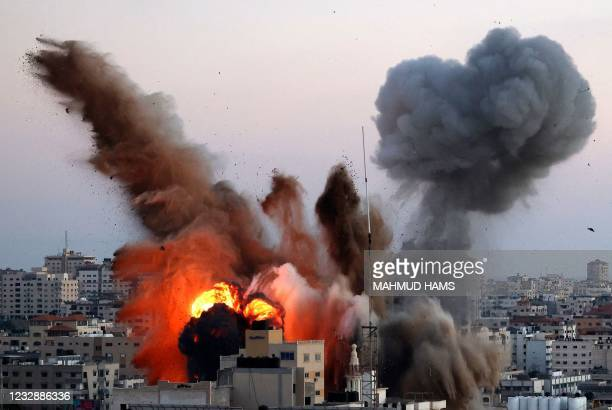 Smoke billows after an Israeli airstrike on Gaza City targeted the Ansar compound, linked to the Hamas movement, in the Gaza Strip on May 14, 2021. -...