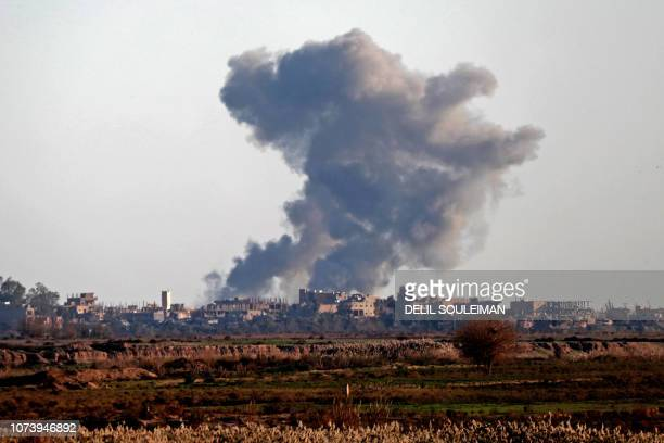 TOPSHOT Smoke billows after bombings in the Deir Ezzor province near Hajin eastern Syria on December 15 2018 Kurdishled forces seized the Islamic...