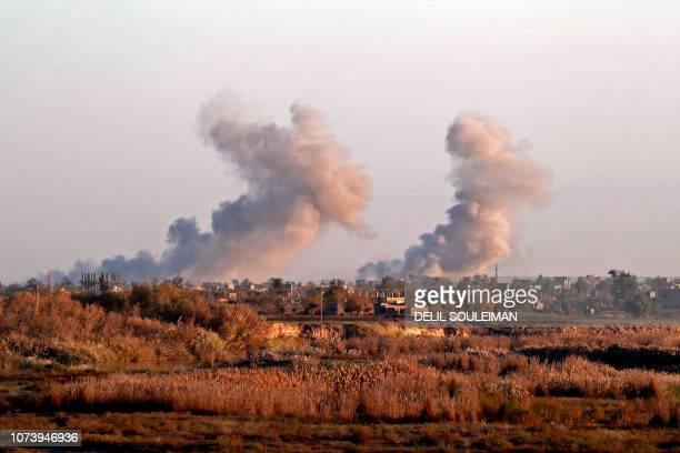 Smoke billows after bombings in the Deir Ezzor province near Hajin eastern Syria on December 15 2018 Kurdishled forces seized the Islamic State's...