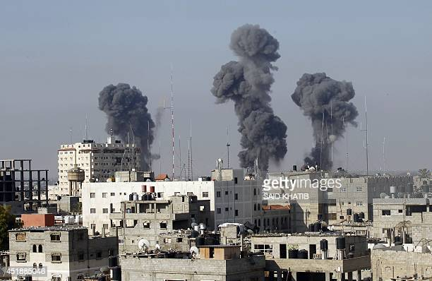 Smoke billows after Israeli air strikes near smuggling tunnels between the southern Gaza Strip and Egypt on July 9 2014 The Israeli air force bombed...