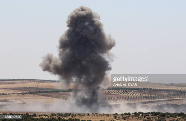 TOPSHOT Smoke billows after reported regime air strikes near Khan Sheikhun in Syria's Idlib province on July 11 2019 Regime and jihadistled forces...