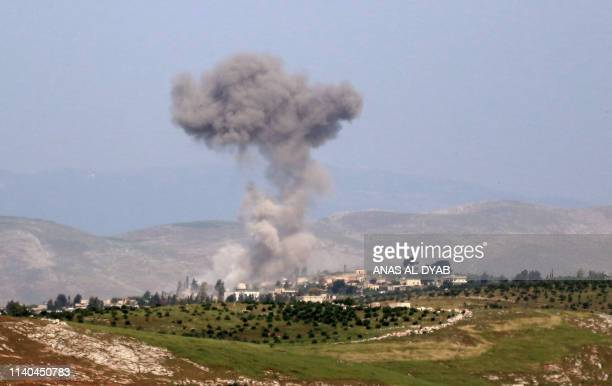 Smoke billows after reported shelling on the Syrian village of Qasabiye in the southern countryside of the jihadistheld Idlib province on May 1 2019...