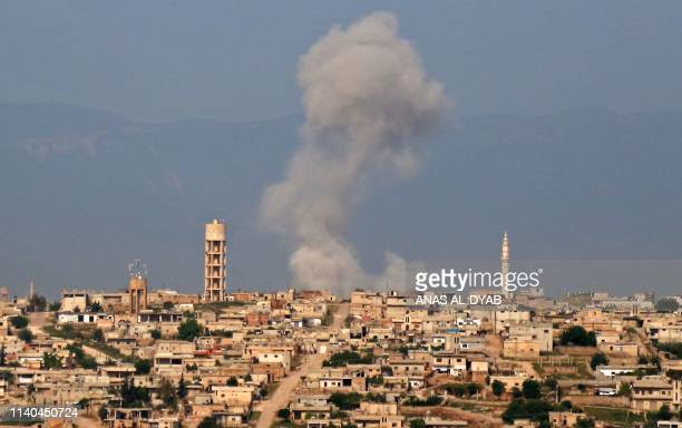 Smoke billows after reported shelling on the Syrian village of Kfar Nabuda in the northern countryside of Hama governorate on May 1 2019 Shelling of...