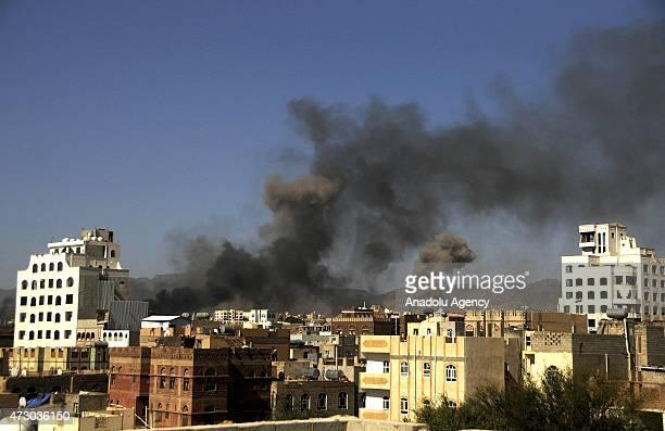 Smoke billows after Saudiled coalition airstrikes hit the Houthi targets in Yemeni capital Sanaa on May 12 as Saudi Arabia and its Arab allies...