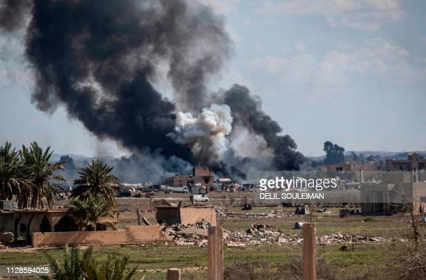 Smoke billows after shelling on the Islamic State group's last holdout of Baghouz in the eastern Syrian Deir Ezzor province on March 3 2019...