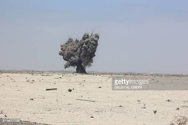 Smoke billows after Yemeni security forces neutralised unexploded ordnance confiscated from the Shiite Huthi rebels and militant extremists in the...