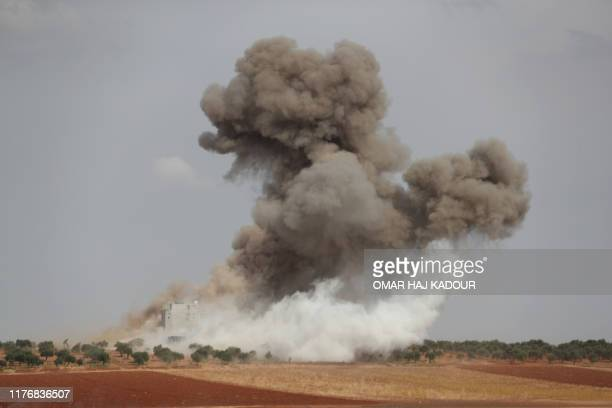 TOPSHOT Smoke billows around a building reportedly hit in Russian airstrikes on the town of Taftanaz and its surroundings in Syrias northwestern...