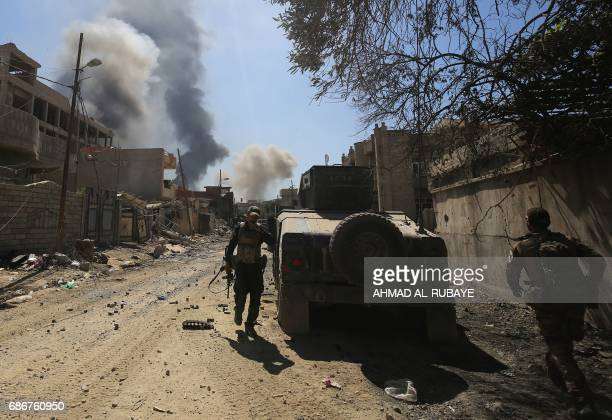 Smoke billows as Iraqi Counter-Terrorism Services advance in West Mosul's Al-Najjar neighbourhood on May 22 during the ongoing offensive to retake...